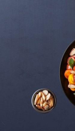 Parmesan sliced almonds over salad